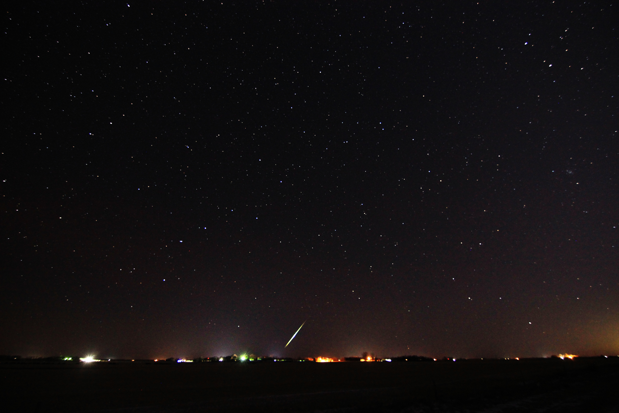 A meteor streaks over the horizon