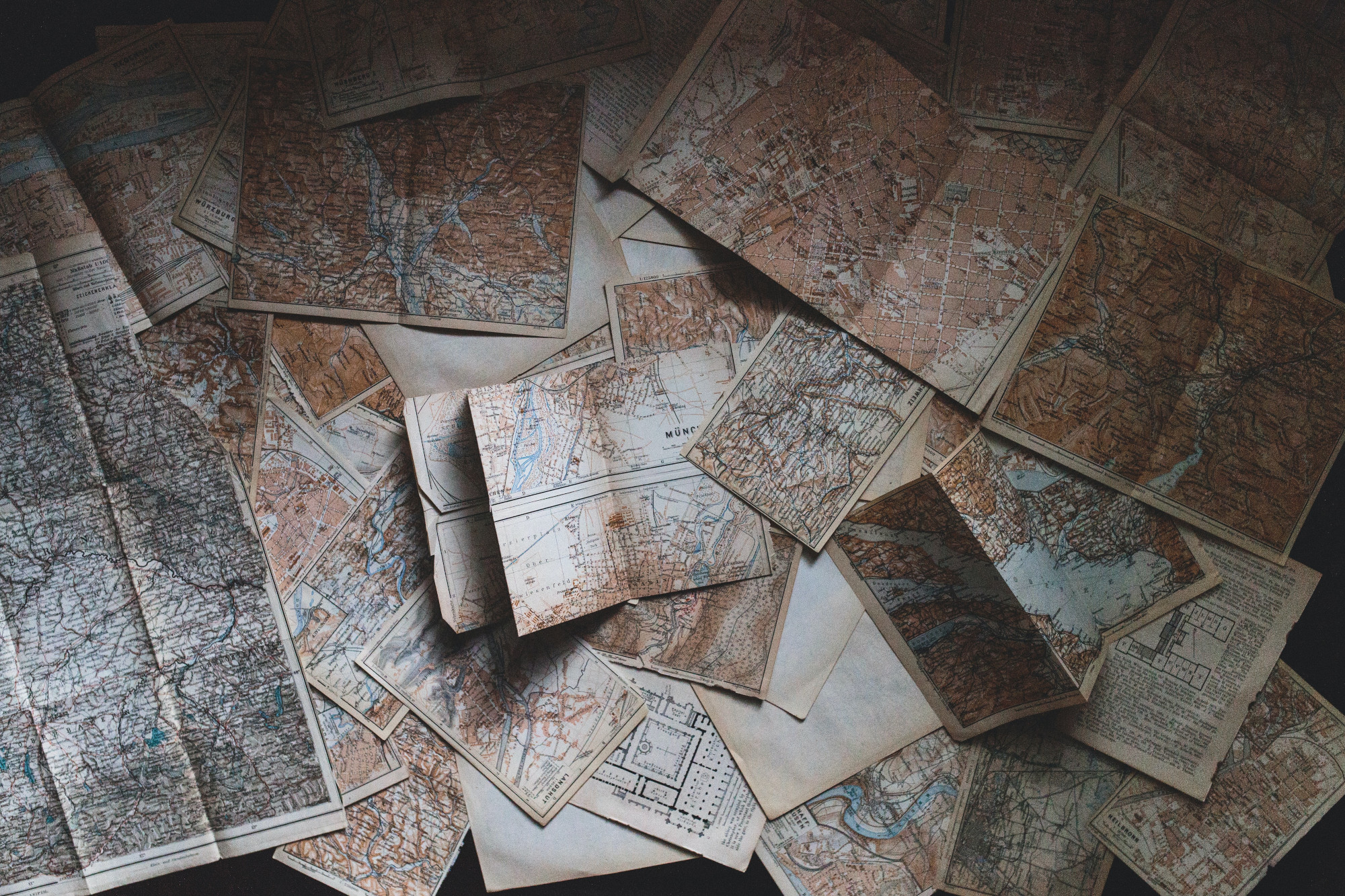 Image: scattered maps and old atlases